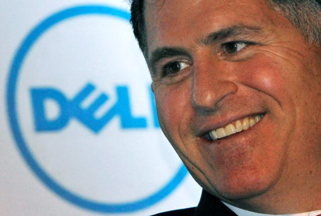 Dell Inc. founder and chief executive Michael Dell smiles during a business conference organised in New Delhi in this March 22, 2011 file photo. Dell Inc is edging closer to an agreement to sell itself to a buyout consortium led by Dell and private equity firm Silver Lake Partners in a deal that could top $24 billion, people familiar with the matter said on Friday.    REUTERS/B Mathur/Files (INDIA - Tags: BUSINESS) - RTR2K8AQ