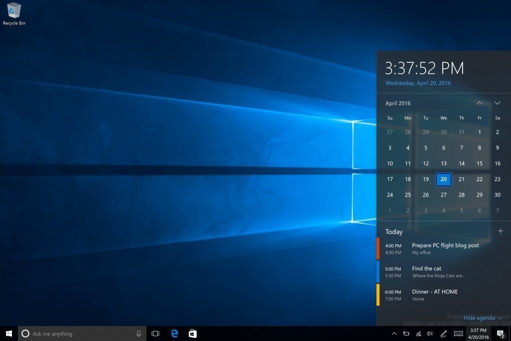 Screenshot einer älteren Windows 10 Version mit geöffnetem Kalender-Flyout. Nicht relevant.